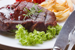 Grilled steak meat. In a plate Stock Photography