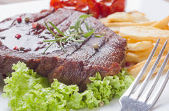 Grilled steak meat. In a plate Stock Photos
