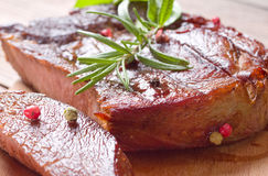 Grilled steak meat. On the plate Royalty Free Stock Image