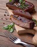Grilled steak meat. On a wooden table Stock Image