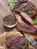 Grilled steak meat. On a wooden table Royalty Free Stock Photo