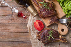 Grilled steak meat. On a wooden table Royalty Free Stock Photography