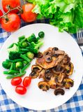 Grilled steak with mushrooms and vegetables Stock Image