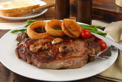 Grilled steak with onion rings Royalty Free Stock Photo