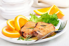 Grilled steak with orange sauce Stock Image