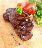 Grilled steak with pepercorns and tomato Stock Images