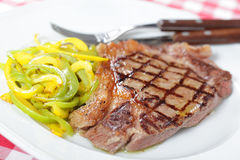 Grilled steak with pepper Royalty Free Stock Image