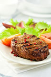 Grilled steak with pink pepper Stock Image