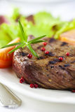 Grilled steak with pink pepper and rosemary Stock Photo
