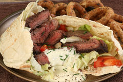 Grilled steak in pitta bread Royalty Free Stock Image