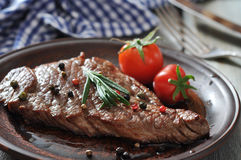 Grilled steak  on plate Royalty Free Stock Photo