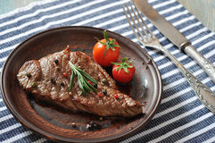Grilled steak  on plate Royalty Free Stock Images