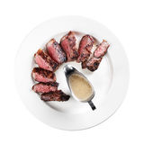 Grilled steak on a plate (white background). Grilled steak on a plate on white background Stock Photography