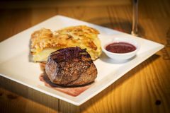 Grilled steak with potato onion and cheese bake Royalty Free Stock Photography