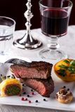 Grilled steak. Steak with grilled potato on a plate Stock Image