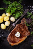 Grilled steak with potatoes Royalty Free Stock Photo