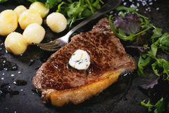 Grilled steak with potatoes Royalty Free Stock Images