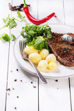 Grilled steak with potatoes Royalty Free Stock Photos