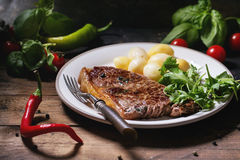 Grilled steak with potatoes Stock Photography