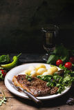 Grilled steak with potatoes Royalty Free Stock Image