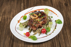 Grilled steak with roasted asparagus stock photography