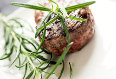 Grilled steak with rosemary Royalty Free Stock Photo
