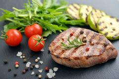 Grilled steak with rukkola Royalty Free Stock Photo
