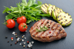 Grilled steak with rukkola Royalty Free Stock Image