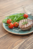 Grilled steak with rukkola Stock Photography