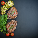 Grilled steak with rukkola Stock Images