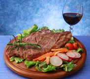 Grilled steak and salad Stock Images