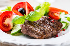 Grilled steak with salad Stock Photos