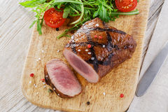 Grilled steak with salad Royalty Free Stock Photography