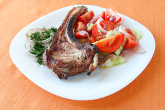 Grilled steak with a salad of tomatoes and cucumbe Stock Photo