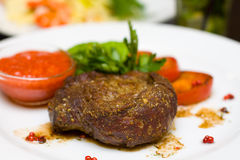 Grilled steak, sauce and tomatoes Royalty Free Stock Photography