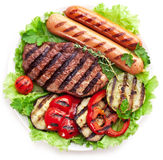 Grilled steak,sausages and vegetables. Royalty Free Stock Photo