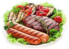 Grilled steak,sausages and vegetables. Stock Photo
