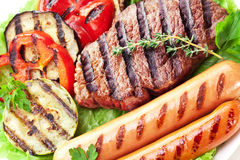 Grilled steak,sausages and vegetables. Stock Image