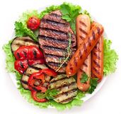 Grilled steak,sausages and vegetables. Stock Images