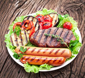 Grilled steak,sausages and vegetables. Stock Photography