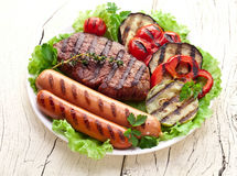 Grilled steak,sausages and vegetables. Royalty Free Stock Images