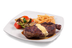Grilled Steak served with Hollandaise sauce, fries, and stir fry / sauteed vegetable. In white background Stock Photos