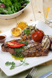 Grilled Steak with Spicy Herb Sauce Stock Photos