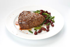 Grilled steak with stir-fried string beans Stock Images