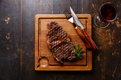 Grilled Steak Striploin and red wine Royalty Free Stock Photos