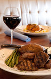 Grilled Steak Tips and Wine. In a restaurant setting Stock Photos