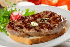Grilled steak on toast bread Stock Photography