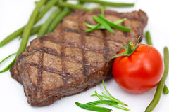Grilled steak with tomato and green beans,isolated Royalty Free Stock Photo