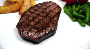 Grilled steak with vegetables Stock Images