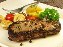 Grilled steak, vegetables Stock Image